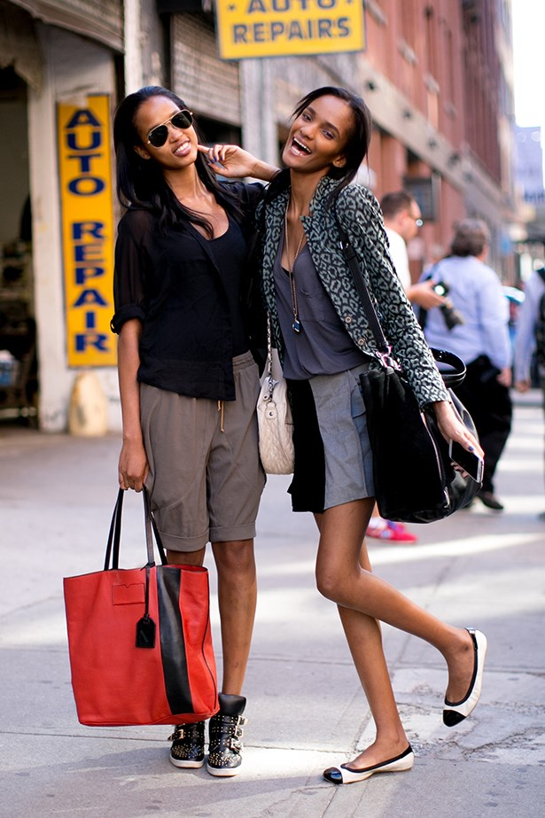 Two models ditch their high-fashion kit and make up for a casual catch-up on the streets of New York.