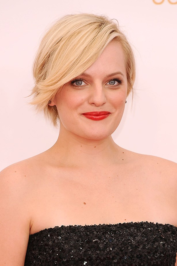 Give a cropped cut a pretty, feminine feel with a flowing sweep and curled up ends like <em>Mad Men's</em>, Elizabeth Moss.