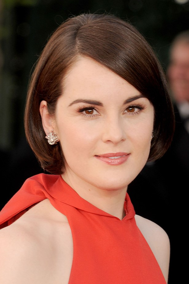 <em>Downton's</em> Michelle Dockery has mega-watt shine to her sleek style. The 'do looks perfectly pretty as a bob, but would be just as flattering as a shorter crop too.