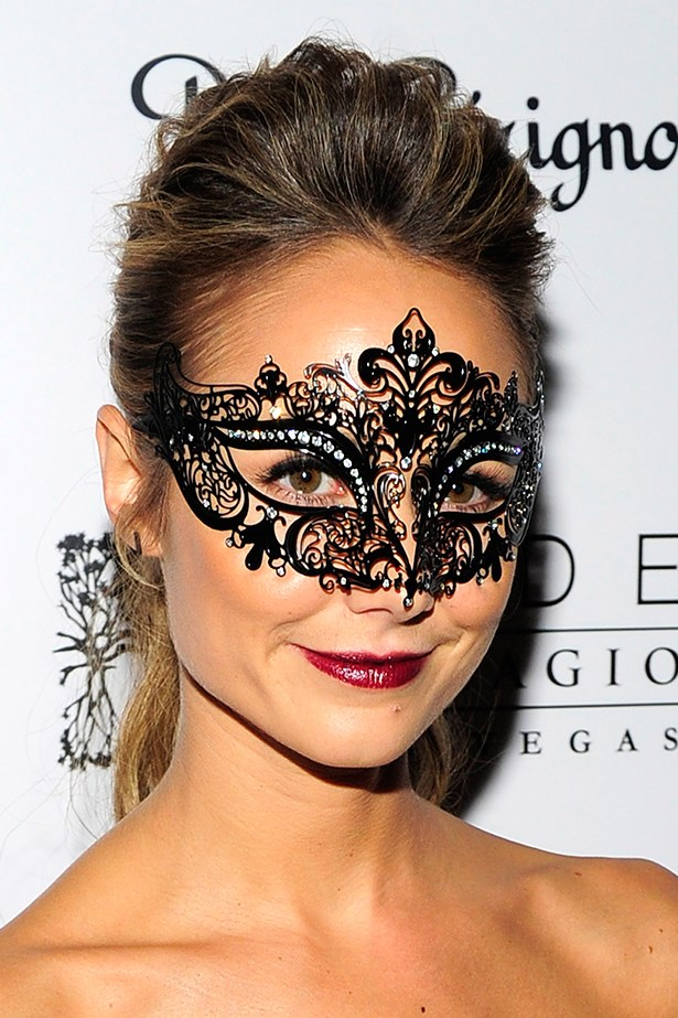 Stacy Keibler nails the masquerade look with a maroon lip.