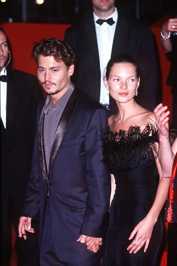 <strong>1998 </strong><br> Johnny Depp looking dapper in that navy blue suit (again!) and Kate Moss wearing a strapless black number to the 51st Cannes Film Festival.