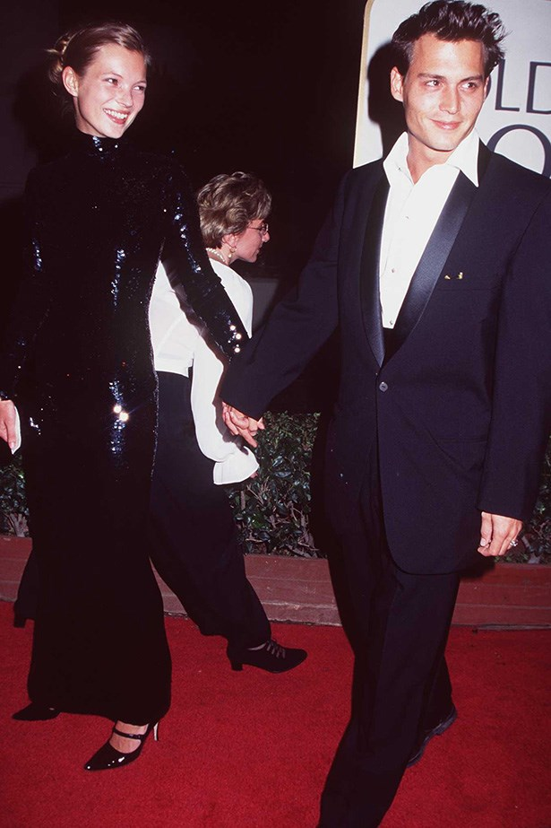 <strong>1995</strong><br> Moss and Depp arriving at the 52nd Annual Golden Globe Awards. Moss wears an embellished long-sleeve sequinned gown and Depp in a blue-tailored suit.