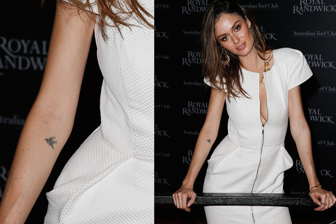 <strong>Nicole Trunfio</strong><br> <strong>Age</strong>: 27<br> <strong>Agency</strong>: IMG <br> <strong>Tattoo</strong>: A black sparrow on her forearm <br> <strong>What you didn't know about her tattoos</strong>: Like Chanel Iman, the Australian model also has a coathanger on the nape of her neck.
