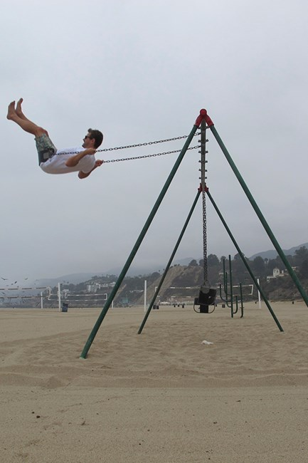 Nick taking a moment to play around on Malibu beach.