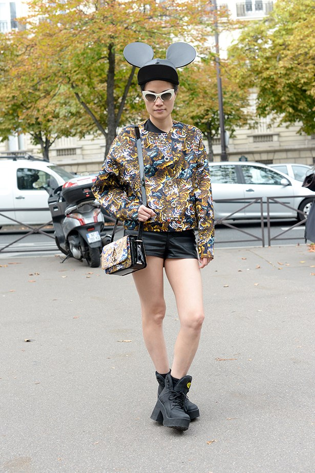Take a step on the wild side and double-up on prints, just like this fashion week attendee did with her bomber and bag.