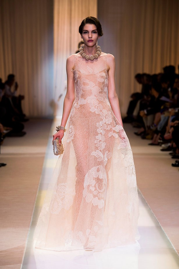 <strong>Armani Privé Couture AW1-14 </strong><br><br> Should Kim choose to celebrate her nuptials in something a little more fairytale, this ethereal Armani Privé gown, with its floaty layers and floral embroidery, would be ideal.