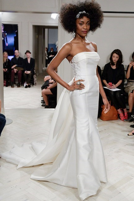 <strong>Badgley Mischka Bridal 14</strong><br><br> Should Kim K opt for a more formal look, this strapless Badgley Mischka number with its majestic train is just right.