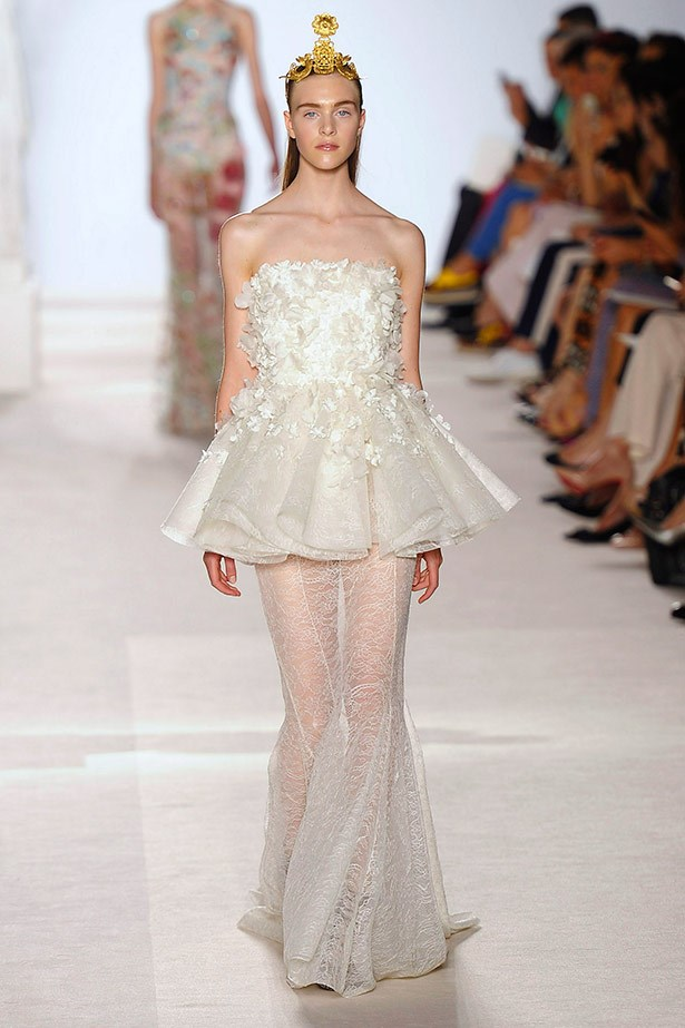 <strong>Giambattista Valli Couture AW13-14 </strong><br><br> Giambattista Valli's couture collection was met with rave reviews, and we love how intricate and ornate this gown is. Fingers crossed Kim picks something like this for her big day.