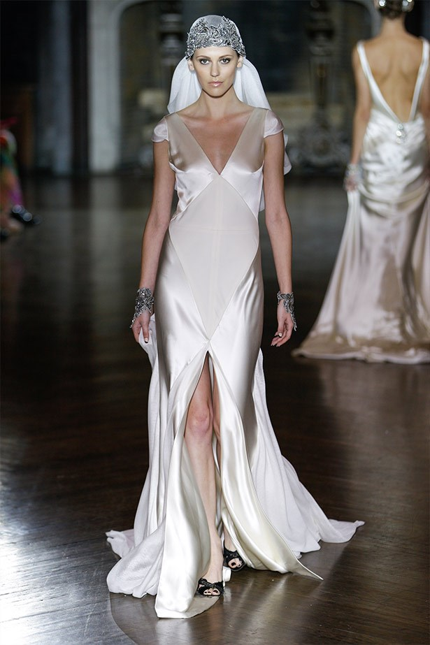 <strong>Johanna Johnson Bridal 14 </strong><br><br> Kim loves a sleek and sexy look, and this boudoir-inspired gown is both minimal and elegant.