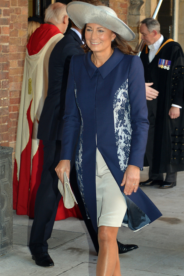Carole Middleton radiated in a cream and navy outfit by Catherine Walker & Co. We loved the delicate lace detailing featured in panels of the coat and a structured collar.