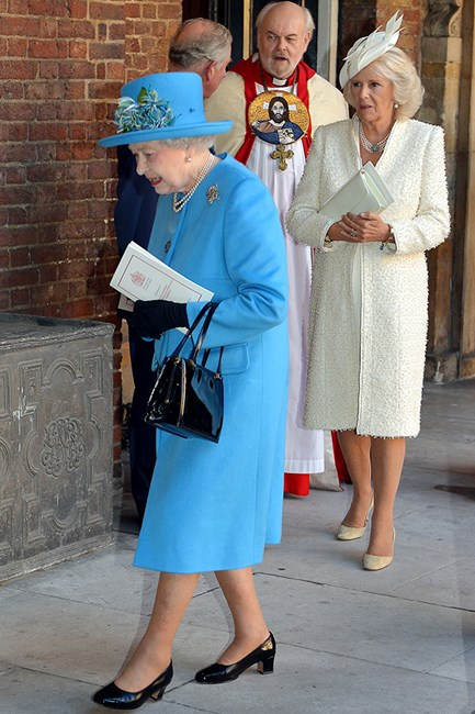 The Queen wore a bright blue outfit teamed with patent leather accessories.
