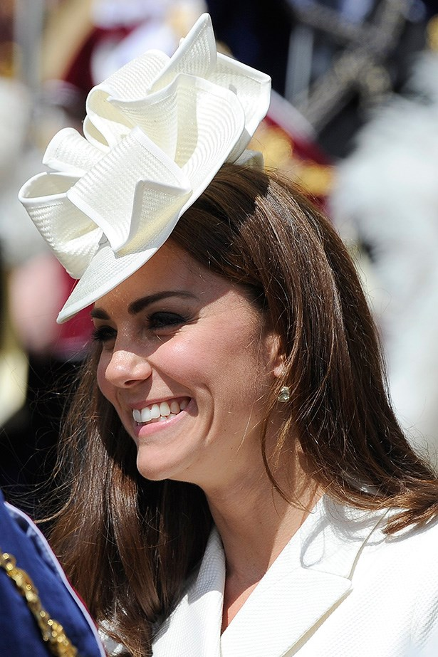 ORIGAMI: Royal trendsetter and milliner's delight, the Duchess of Cambridge wore a cream Jane Corbett hat last year. The crisp origami folds of her hat were softened with Kate's pink blush and rose lips – plus her signature black eyeliner.