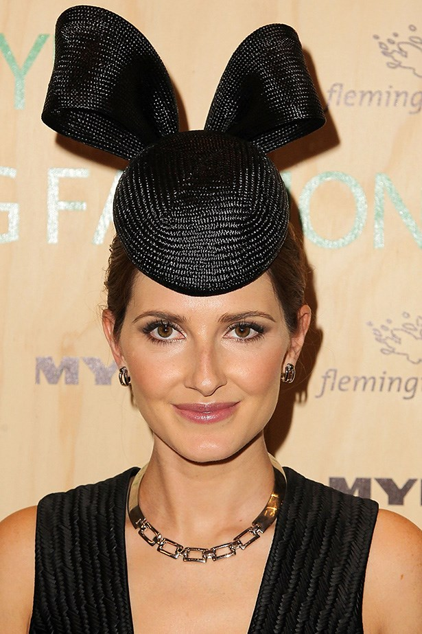 STATEMENT: Australian racing royalty Kate Waterhouse knows the rule of the track – a statement hat means swept-back hair. She kept her makeup simple, with brown smoky eyes and shimmering lipgloss.