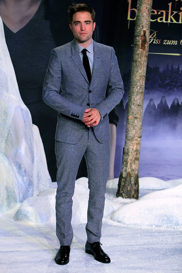 Robert Pattinson looks sharp in this icy grey suit worn with black patent shoes.
