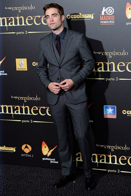 Rob looks at home in this Dolce & Gabbana suit and his burgandy tie compliments it perfectly.