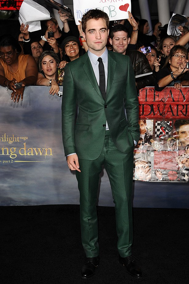 There's no such thing as playing it safe for Rob, here he stands in a forest green number by Gucci.