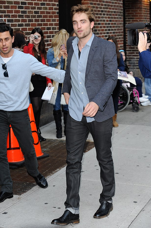Same look different day. This time Rob bares a little chest in a blue shirt, sprused-up by a navy blazer.