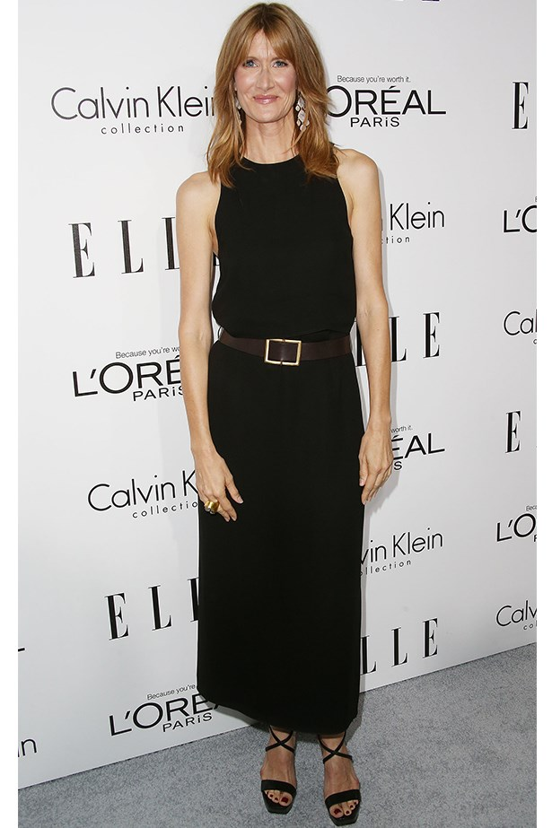 Laura Dern wore a classic Calvin Klein black slip dress and accessorised with a wide belt.