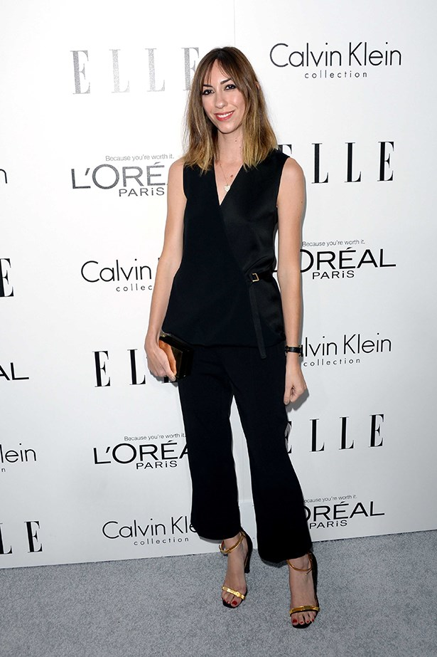 Gia Coppola wore a relaxed black outfit highlighted with gold shoes and clutch.