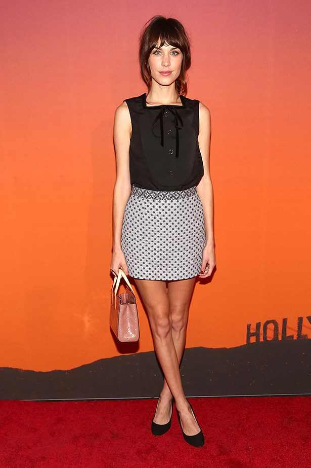 Alexa Chung looks school-girl chic in this blouse and skirt combo.