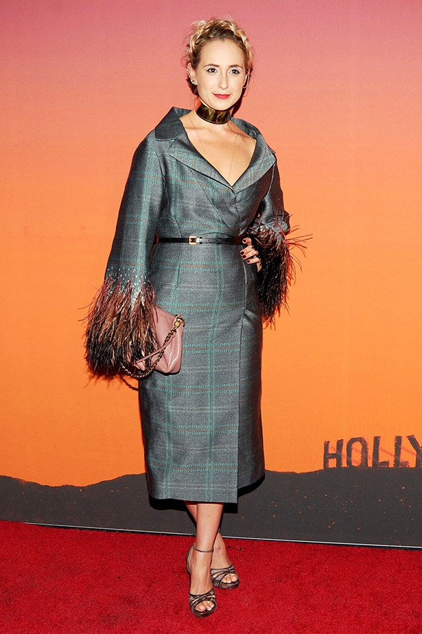 Elisabeth Von Thurn und Taxis makes a statement in this Louis Vuitton coat and gold collar.