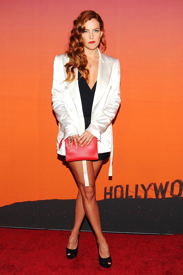 Riley Keough looks seriously fierce in Louis Vuitton's silk blazer.