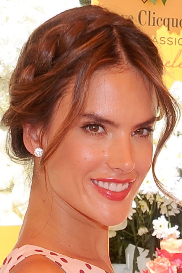 Alessandra Ambrosio wears a polished braid with soft face framing pieces at the Veuve Clicquot Polo Classic.