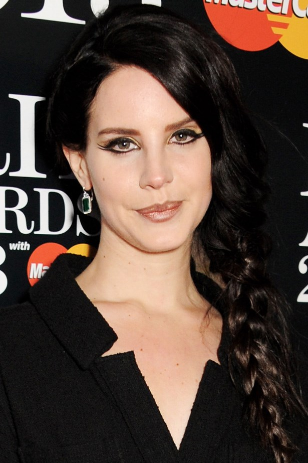 Arriving at the Brit Awards, Lana Del Rey shows off a long, dark braid, softened with wispy strands.
