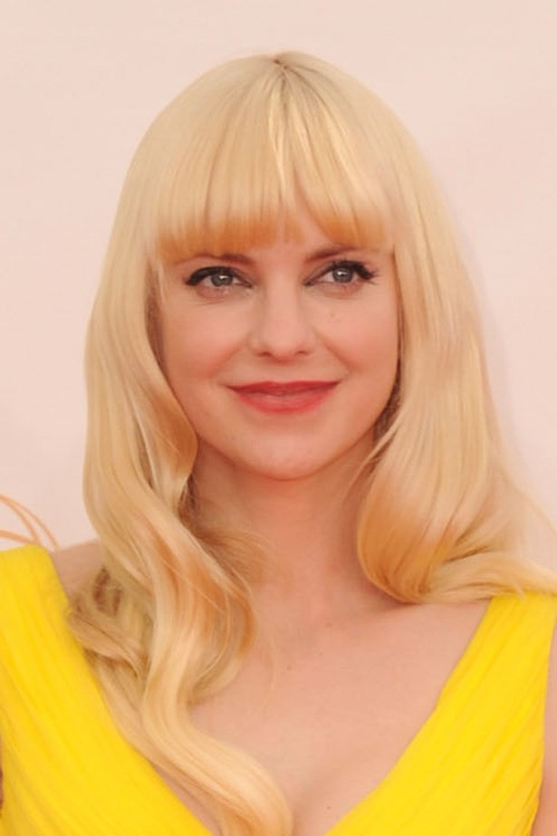 Anna Faris works a fringe with glamourous, polished waves at the 65th Annual Primetime Emmy Awards.