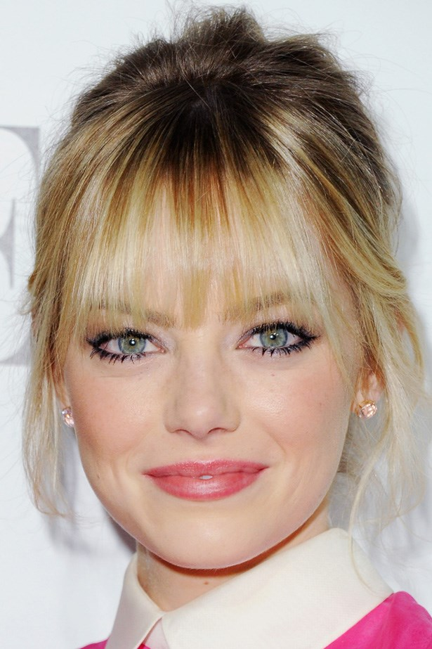 Emma Stone pairs a wispy blonde fringe with lashings of mascara at the 19th Annual Elle Women in Hollywood Celebration.