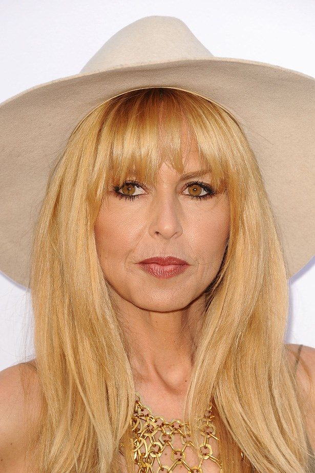 Rachel Zoe accessorises her fringe with a statement hat at a Mother's Day Garden Party in Los Angeles.