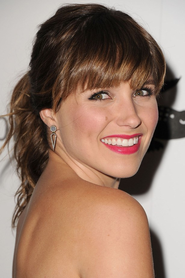 While attending an opening at the Beverly Hilton, Sophia Bush pairs her bangs with a statement pink lip.