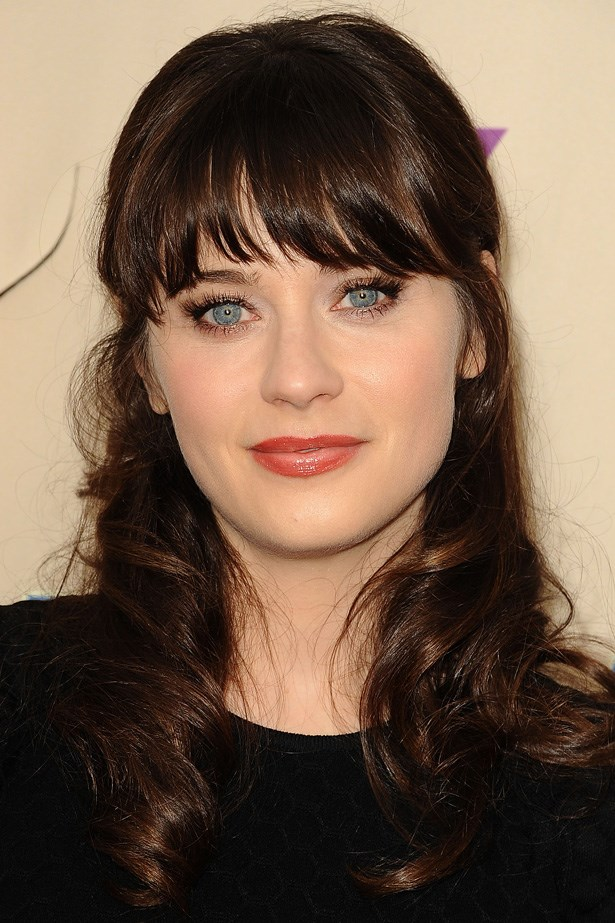 No list of the top celebrity bangs would be complete without the queen of the fringe, Zooey Deschanel, rocking her statement 'do at a screening of her show 'New Girl'.