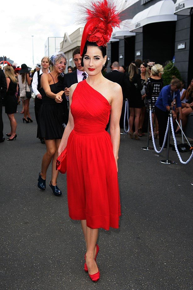 """<p><strong>Leona Edmiston</strong>: """"Matching can be chic! I adored Dita Von Teese in a flaming scarlet dress at Derby Day in 2011 wearing an outrageously mad Philip Treacy hat to match.""""</p> <p>Dita Von Teese poses during Derby Day at Flemington Racecourse on October 29, 2011 in Melbourne, Australia</p>"""