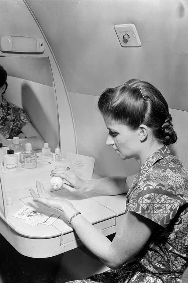 """<p><strong>Kym Ellery</strong>: """"Drink lots of water to stay hydrated and pack some trusty makeup essentials for regular touch-ups in the powder room.""""</p> <p>Lady in powder room 1952</p>"""