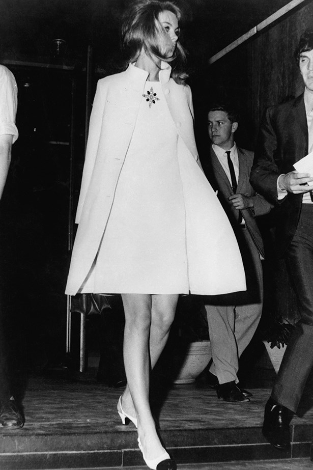 """<p><strong>Kym Ellery</strong>: """"Keep it chic. Take your cue from Jean Shrimpton in a chic white mini and black-and-white pumps. Perfection.""""</p> <p>British fashion model Jean Shrimpton in a matching white knee-length dress and coat, Australia, 1965</p>"""