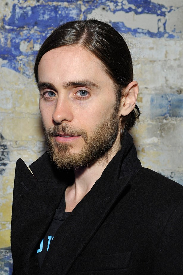 30 Seconds To Mars front man, Jared Leto rocks a side parted man-bun with impressive facial hair.