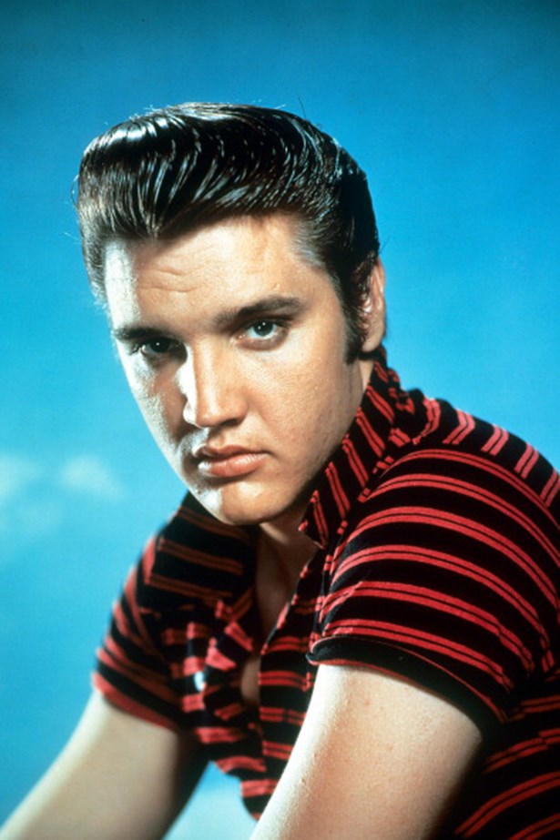 50s: Elvis Presley. Presley's combed-back and glossed-up look defined a whole era of grooming habits.