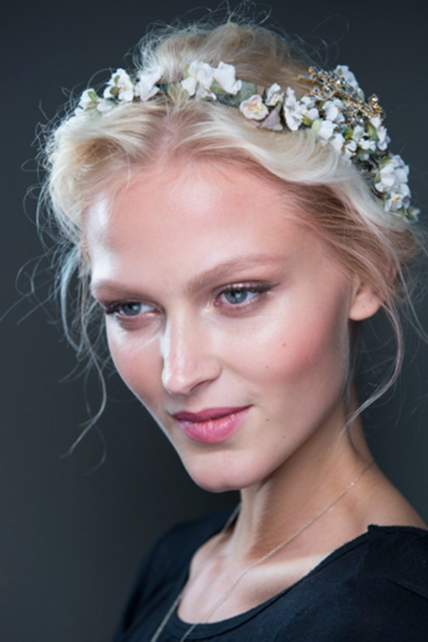 NYMPH: Models were crowned with gold coins and flower wreaths at Dolce & Gabbana's SS14 show. The look was finished with a halo of whispy fly-aways around the model-maiden's faces. Mythical and romantic.