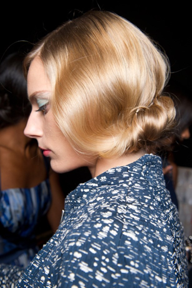 VINTAGE: The hair at Badgely Mischka's  SS14 catwalk was all about the soft wave, and upturned chignon in manner of Grace Kelly and all 1950s Hollywood dames.