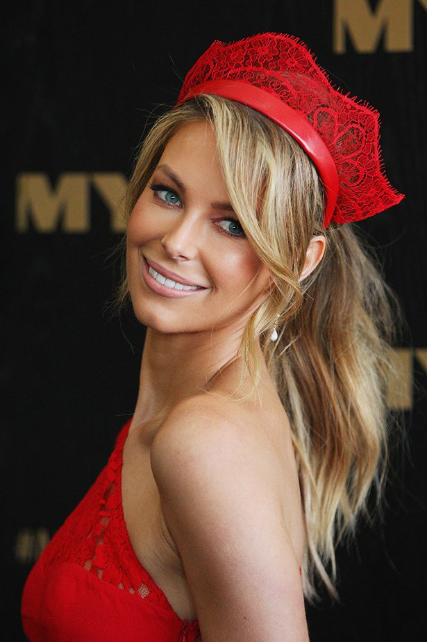 Jennifer Hawkins' soft-wave ponytail and fresh, blushing makeup is a hit with her feminine lace dress.