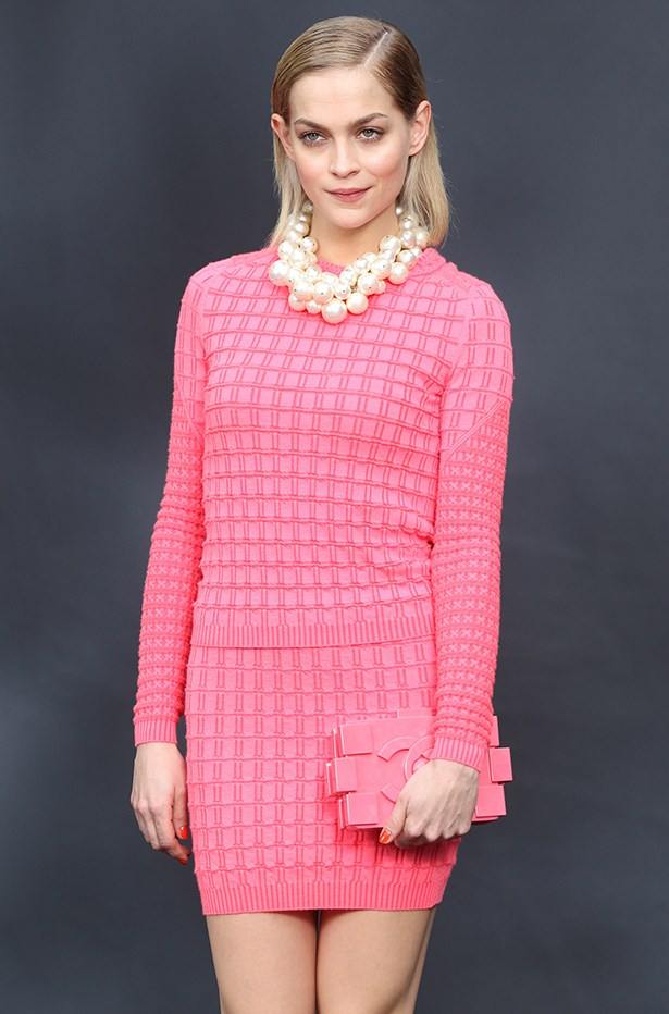 Leigh Lezark pairs her clutch with head-to-toe pink and a statement Chanel pearl necklace.