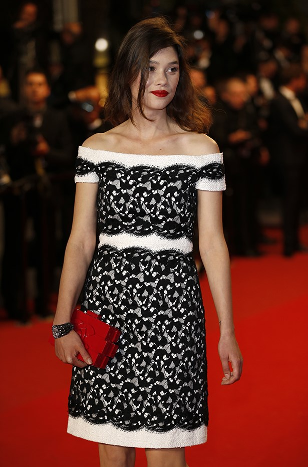 Astrid Berges-Frisbey looks like a Parisian dream with her clutch in Cannes.