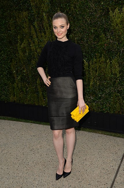 We love the canary yellow shade of Australian actress, Bella Heathcote's clutch.