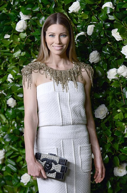 Jessica Biel looks lady-like with her pearled Chanel clutch.