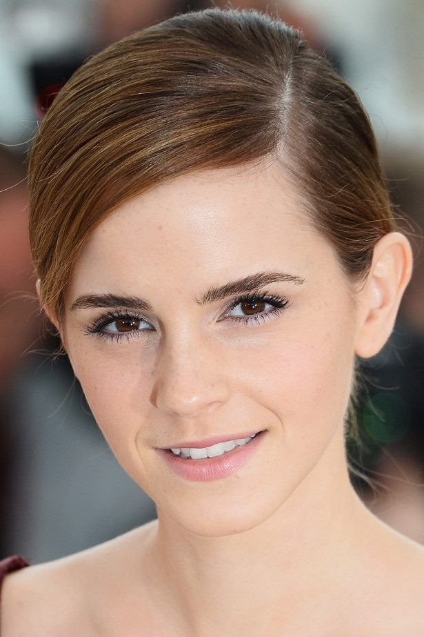 Emma Watson's ever-changing hair looks chic slicked down to one side.