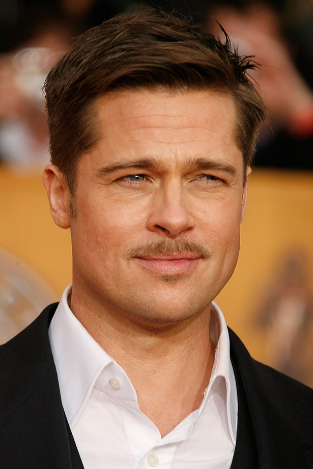 Looking dapper in an unbuttoned shirt, Brad Pitt attends the 15 Annual Screen Actors Guild Awards in Los Angeles.