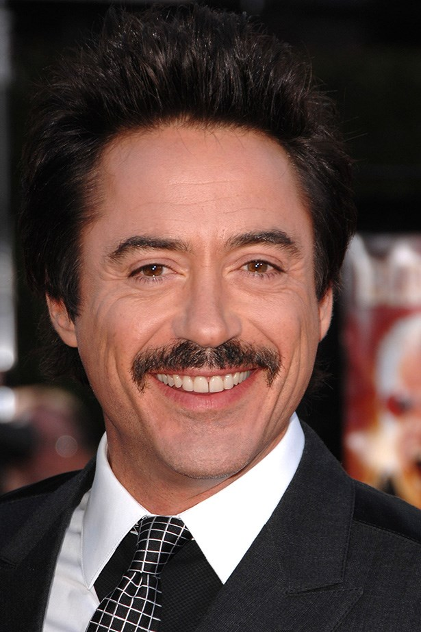 This 'Iron Man' Robert Downey, Jr. traded in his signature goatee for a thicker 'stache at the Los Angeles premiere of 'Tropic Thunder' August 11, 2008.