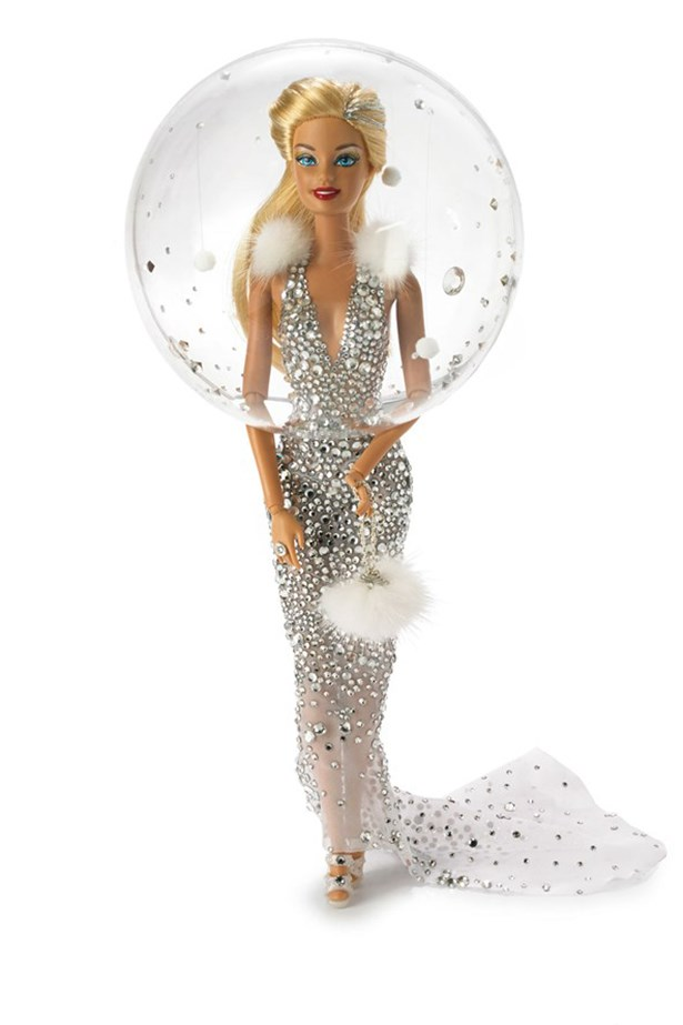 """<strong>Snow Globe Barbie</strong> """"For when Barbie needs to go down a red carpet. There is nothing more magical and glamorous than floating snowflakes encased in a snow globe"""" – Stephen Jones"""