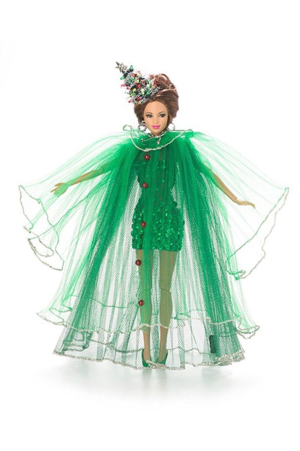 "<strong>Christmas Tree Barbie</strong> ""Part of the joy of Christmas is dressing up a Christmas Tree, and of course Barbie needed this to be a part of her wardrobe. I ensured the drama and volume of a full pine tree, and of course dressed it with a present from Santa and multi-coloured baubles which light up"" – Stephen Jones."